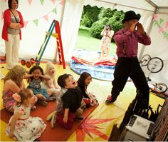 Entertainers tent for kids area at wedding, installed by www.24carrotevents.co.uk