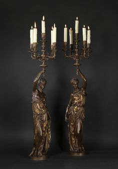 * A Pair of Gilt and Patinated Bronze Figural Five-Light Candelabra French, Circa 1880.