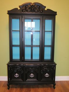 Black and turquoise china cabinet.....This is mine girls eat your hearts out!!! ;)