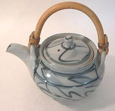 Harry and May Davis - Crowan Pottery - Stoneware teapot, approx. 10.5cm high to the lid and 16cm. including handle, stoneware with cane handle, light grey glaze with cobalt blue brushwork