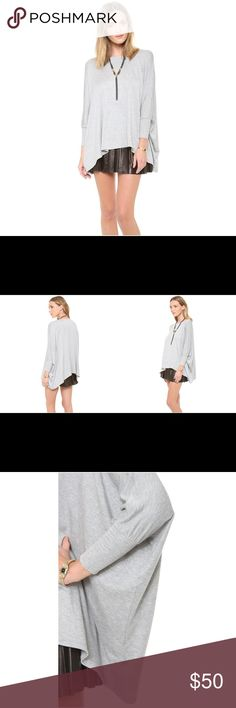 Alice + Olivia Update your casual look in the AIR by alice + olivia Boat Neck Rectangle Tee featuring boat neck. This AIR by alice + olivia Boat Neck Rectangle Tee will make a perfect new addition to your casualwear portfolio. NWOT--selling color in first image others for modeling purposes Alice + Olivia Tops Tees - Short Sleeve