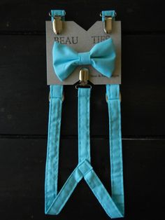 This Tiffany Blue Bow Tie/ Suspenders set is perfect for the little beau in your life! Dress up any outfit with these easy to attach bow ties,