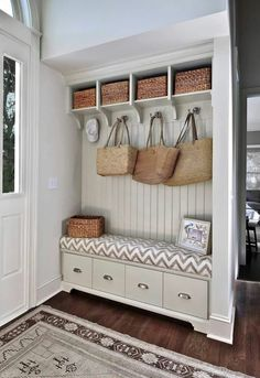 Maybe in the HUGE foyer. Add a partial wall instead of doing all railing along the basement stairway.