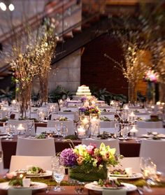 In a large space, such as Bay 7,  highlighting a cake and florals with light brings attention to these personal choices.  Lighting by Get Lit, Special Event Lighting.