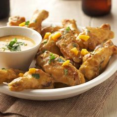 Try out some food trends -- sriracha, coconut milk, lime, and mango are all in this punchy wing recipe. A nice variation from expected buffalo wings, you'll be serving up a favorite food with a flavor twist.  /
