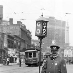Policeman Charles Hillman Standing Beside a Traffic Signal in Indianapolis (1918)