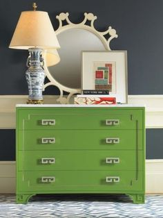 pretty combo of green dresser & navy/white walls