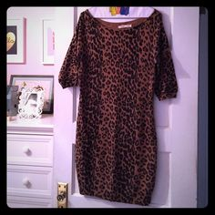 Old Navy Leopard Print Knit Dress Form fit leopard print knit dress 36 inches from shoulder seam to hem. Great worn as a tunic over leggings or skinny jeans or as a minidress over tights. It's sleek enough to wear as a top under a cute circle skirt or knife pleat skirt. Let it take center stage or mix it with a wild print! Old Navy Dresses Mini