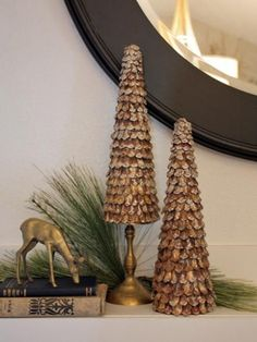 At first glance, you would never know these glittery topiaries are made with pinecones. To make them, hot-glue glittery pinecone petals to cone-shaped Styrofoam. To add visual impact, place some of the cones on candleholders. Design by Michelle Edwards