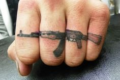 #knuckle  A continuous image like this would be cool, but definitely no guns. Feather? Moth? Henna-like design? Extremely ornate skeleton key? vintagey steam-punk design?