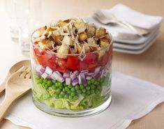 7 Layer Caesar Salad - 1. Layer lettuce, Prepared Sweet peas, dressing, onion, tomatoes, croutons and cheese in large glass salad or trifle bowl.