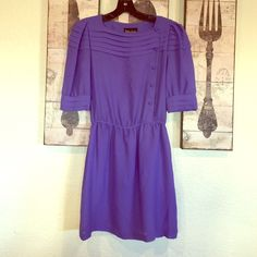 """Vintage purple dress Asymmetrical front button down. Unlined Chiffon feeling fabric. Says 5/6 but elastic waist measures 12""""-16"""", 30"""" neck to hem. Approx small Vintage Dresses"""