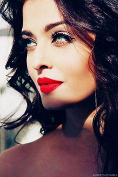 red lips, dark eyes, loose waves. Aishwarya rai
