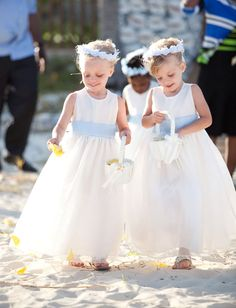 Loving the powder blue sashes and flower crowns on the #flowergirls in this beach wedding. For more flower girl tips, tricks, inspiration & ideas, visit us at www.flowergirlworld.com