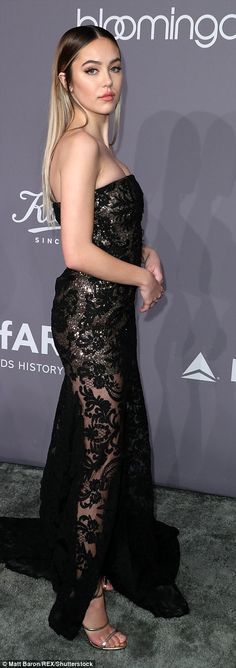 Delilah Belle Hamlin, the 19-year-old daughter of Lisa Rinna and Harry Hamlin, wore a strapless black embellished dress with semi sheer patterned skirt