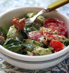 Lobster and avocado salad with tomatoes and fresh basil.