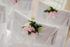 wedding chair cover with pink flowers stock photo