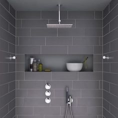 modern shower with dark grey tiles and niche - this looks so spacious!