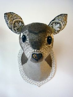 This faux animal head is super cute for a woodland themed nursery!