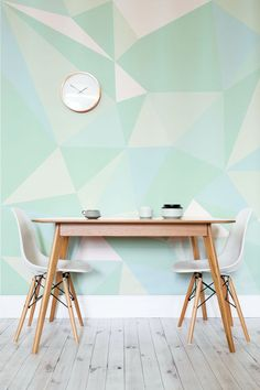 Dining table by a geometirc green wall