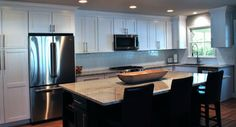 White cabinets and wood tone island to match floor or other wood tones.