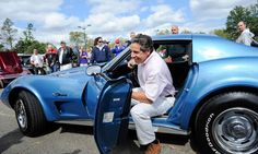 NY Governor Andrew Cuomo and his 1975 Bright Blue Corvette attend a car show.