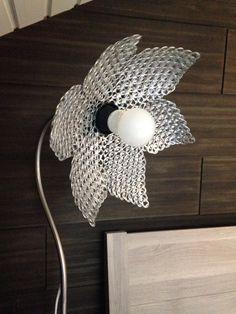 A lamp shade made from soda tabs