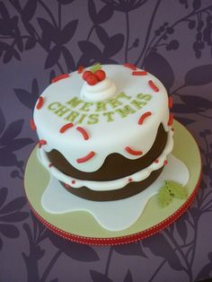 Drippy icing Christmas cake by designercakecompany