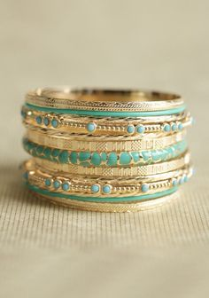 Turquoise and gold bracelets.. I've always loved this combination.
