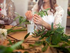 Tip #4: Start Arranging With Greens - 7 Tips for Creating Beautiful Flower Arrangements at Home on HGTV, To help an arrangement last longer, strip the stems of most of the leaves, especially any that will be in the water. Leaves in the water have a tendency to rot, and will cause the entire arrangement to die more quickly. Add greens and foliage to create the initial shape of the arrangement