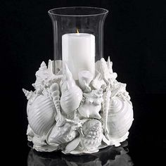 upcycle, paint ,shells, glue onto glass vase . candle holder to match specific party decor