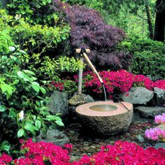 Perfectly crafted, handmade fountain is just one of the details that make this forested hillside garden such an experience.  Everywhere you turn there's something new to see, and as you wander beneath the lush tree canopy, you can hear the soothing   sound of water running through creeks and cascading in fountains and waterfalls.