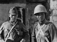 A Japanese naval landing force soldier with a Japanese Army soldier. (southern China, 1939) Although the navy and army had quite the interservice rivalry, they often worked together.