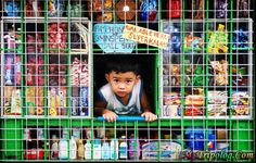 Sari-sari Store; they are EVERYWHERE. Little cages with soap sachets, cell phone minutes, Coca-Colas, and cracker nuts...