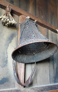 An Angami handmade basket hanging upside down. These types of baskets are traditionally used by the Angami tribe, (largest ethnic group of Nagaland, India) and are worn on the back with the weight being carried mainly by the carriers head, using the headstrap.  Image credit Rita Willaert.