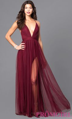 Image of long sexy prom dress with deep v-neckline. Front Image