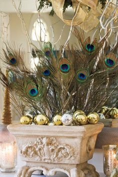 Make a Statement with Peacock Feathers - 100 Fresh Christmas Decorating Ideas - Southernliving. Use peacock feathers in lieu of traditional holiday flowers for a mantel that makes a statement. When paired with mirrored ornaments and curly willow branches they add just enough color to complement the Christmas tree.