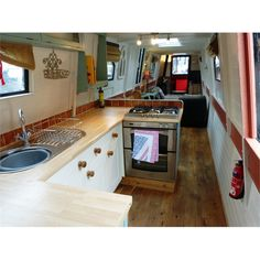 OCTARINE                           £39,950                                                                                  71ft 6ins (21.8m) Trad-stern Narrowboat 1979             with amidships engine room + Lister HRW3 engine             Built by Hancock & Lane       Re-fitted by owner 2010                                                                      HULL:                          Originally built to high standard with... Narrowboat Kitchen, Narrowboat Interiors, Barges For Sale, Canal Boat Interior, Barge Interior, Narrow Boat, Floating House, Boat Design, Boating