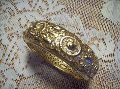 Vintage Jewelry - Gold Tone Filigree Bangle Bracelet. $16.00, via Etsy.