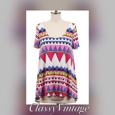 Fun Aztec print tunic. Made in USA NWT Scoop neck tunic top in Aztec print. High low hem. Fun print and these run true to size. Made in USA. 92% polyester and 8% spandex. This is size Large The Hanger Tops Tunics