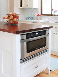 Find the right place in your kitchen for this essential small appliance. See seven ways you can integrate a microwave into your kitchen layout.