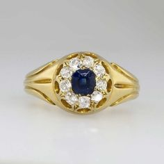 A beautiful heirloom quality newly polished natural rich blue sapphire and old mine cut diamond ring from the Victorian era in a rare finger size 9. It is stamped WGSG 18k and has prominent UK hallmarks