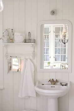 A pretty cottage bathroom. Love the little shelf.