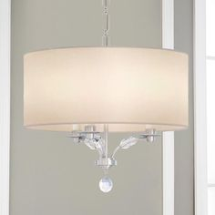 """Small Modern Crystal Bead Shade Chandelier Crystal beads adorn the curved arms of this shade chandelier to create a modern jeweled look. The white linen drum shade sheilds the lamps and provides a soft light. Hang over a breakfast table or use as a semiflush in your foyer or use both ways in your space to coordinate your lighting. This light is sure to catch attention with all of its bling. 3x60 watt candle base bulbs. (19""""Hx18""""W)"""