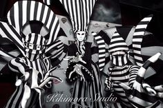 Sister Kikimora Creatures Zeeb and Raa with Harlequin mime on stilts in stunning Dark Circus theme. Creepy cool clowns, mimes, and couture entertainers for your next event! High fashion circus for one of a kind guest experiences!     - Photo by Maxson Media.   - Black and white, circus, luxury event, Miami Fort Lauderdale events, tuxedo, black tie, freaks, festivals and galas.