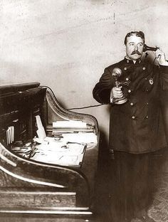 New York City Police Dept. Inspector McCafferty, on telephone. 1908