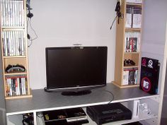 """My setup as of December 2009.  I've got a 22"""" HD Ready TV with Xbox 360 Elite, Playstation 3 (40GB), Nintendo Wii, Playstation 2 and N64 hooked up to it in some form. The only thing I really use the HD for in the Xbox atm. 3 racks to hold games; I've Gaming Panda offer a complete range of buying guide for Pc games digital download. - http://www.gamingpanda.net"""