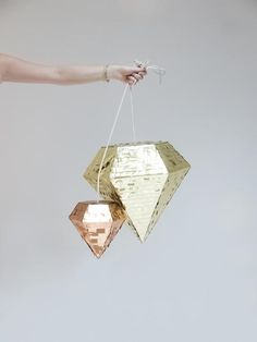 Fun blingy pinatas! Would be super fun for a NYE party :) Wonder what to put inside?