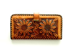 Our gorgeous vintage hand tooled wallet is made from genuine leather and features a sunflower design on both front and back. Two large compartments to hold cash, one medium sized zippered compartment, and two snap button pouches. Mirror slightly rusted but can be easily removed by sliding out and replaced.