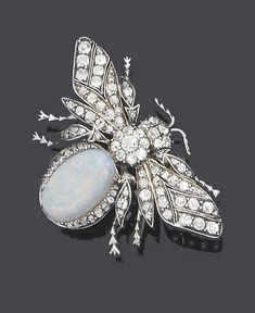 An opal and diamond bee brooch Realistically modelled as a bee with old brilliant-cut diamond openwork wings and abdomen, with rose-cut diamond detail, to a later oval cabochon opal body with diamond border detail, composite, diamonds approx. 1.70ct. total, length 4.9cm.: